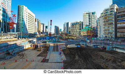 A timelapse of moving cranes at the under construction in Shibuya Tokyo wide shot