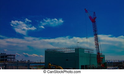 A timelapse of moving cranes at the under construction in Tokyo wide shot