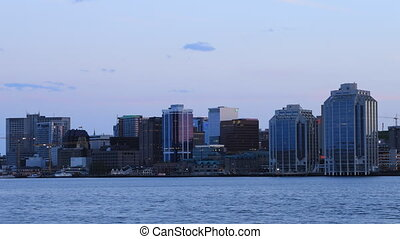 Timelapse of the Halifax, Canada skyline as night falls - A...