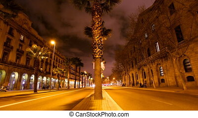 a timelapse scene at night in barcelona, spain