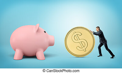 A tiny businessman rolls a huge golden dollar coin in the direction of a giant piggy bank.