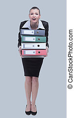 A tired businesswoman is holding a folder. Isolated on
