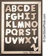 A to Z alphabet colorful wooden word on black board3