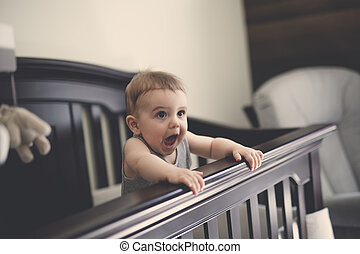 Toddler baby in the crib on the bedroom