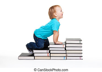 A toddler creeping for knowledge on the steps made of books