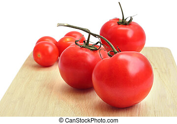 a tomato on chopping board