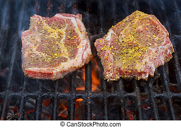 A top sirloin steak flame broiled on a barbecue,