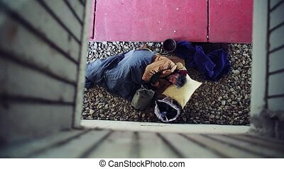A top view of homeless beggar man lying on the ground...