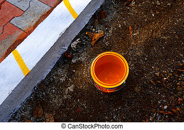 top view of yellow color paint can isolated on ground