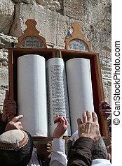 A Torah Scroll is Raised - A Torah scroll is raised at the...