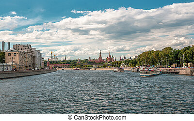 A tourist ship is moored to a pier on the Moscow river.