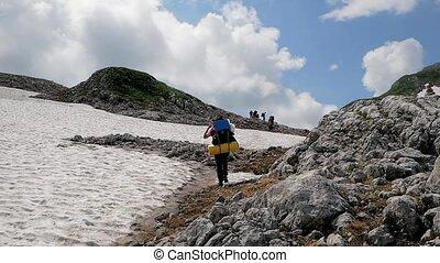 A tourist walks through the mountain pass