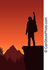 A tourist with a backpack standing on the top of a mountain and enjoying
