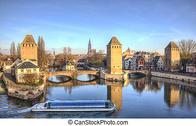 Ponts Couverts in Strasbourg, France - A touristic ship with...