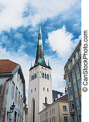 A tower of Saint Olaf's Church in the center of Tallinn Old town on cloudy day.