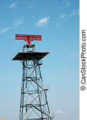 a tower with red radar