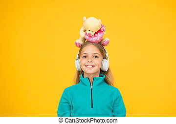 A toy bear hug for you. Happy small child hold soft toy on head. Little girl smile with valentines toy. Teddy bear with love you inscription. Plaything. Valentines day. Toy shop. Buy gifts for kids