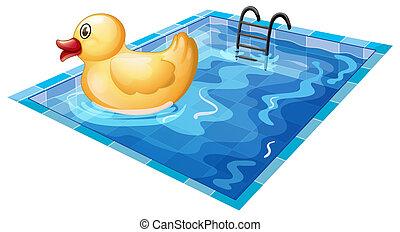 Duck pool float. A cartoon yellow duck pool float in water.