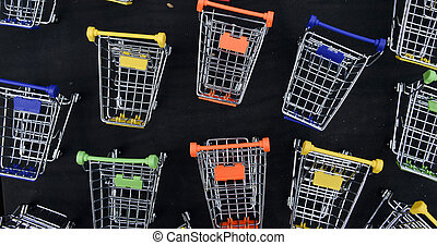 A toy shopping trolleys on black background
