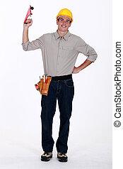 A tradesman holding a plane
