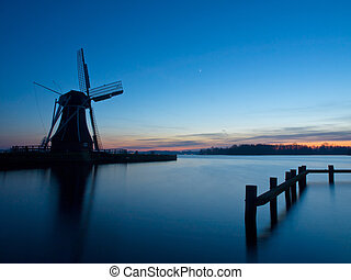 A traditional dutch windmill during dusk
