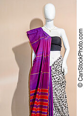 A traditional indian silk saree displayed for sale