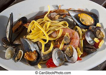 linguine allo scoglio - a traditional Italian sea dish:...