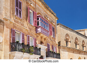 A traditional Maltese style openwork balconies on one of the residential houses of Mdina. Malta