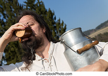 traditional milk farmer drinking in the nature