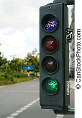 traffic light - a traffic light with green light and blue...