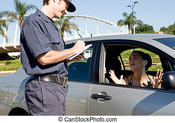 a traffic policeman in uniform writing out a ticket to a pleading woman in car
