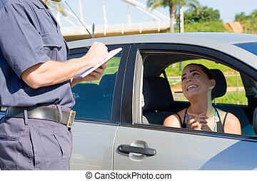 traffic policeman - a traffic policeman writing a ticket to...