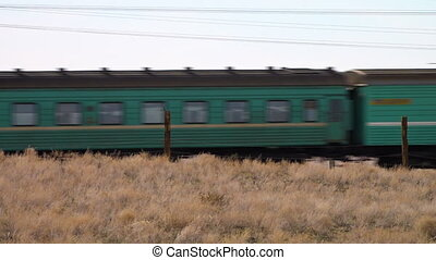 A train on a desert - A scenic shot of a train running on a...