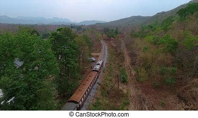 A train running across a field - An high angle shot of a...