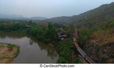 A train running on rails close to a cliff - An aerial shot...
