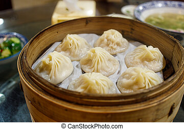 A Tray of Chinese Dumplings with Soup Inside