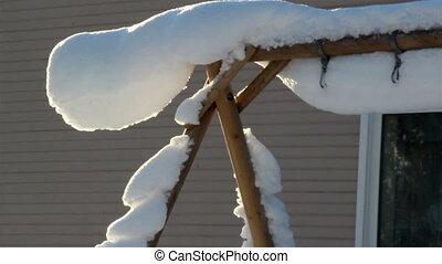 A triangular pole full of snow