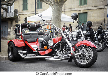 A tricycle to a gathering of American motorcycle in the town