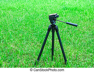 tripod for the camera on natural background