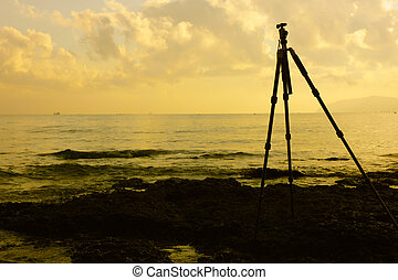 a tripod is on the beach ready to use