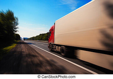 a truck is driving down the road