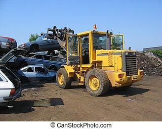 A truck lifting a ca