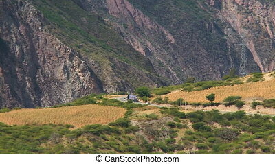 A truck moving on a curved road - A still long shot of a ...