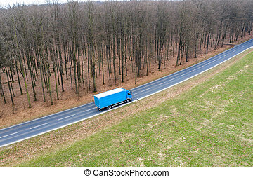a truck on a country street from above