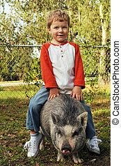 A True Piggy-Back Ride - A preschool boy riding on the back...