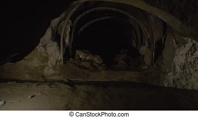 A tunnel underground - A medium shot of a tunnel underground