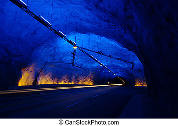 A tunnel with blue stopping bay with the front lights of a car (Long-time exposure)