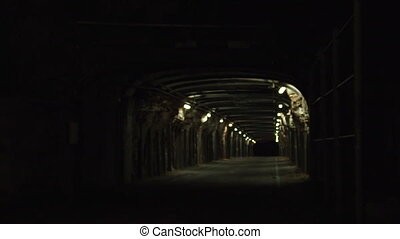 A tunnel with lights inside it - A full shot of a tunnel...
