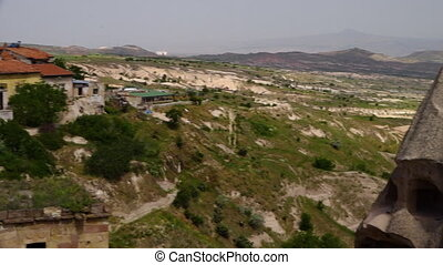 A Turkish village with rock formations, countryside and mountainous terrain