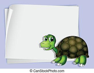 A turtle beside an empty paper